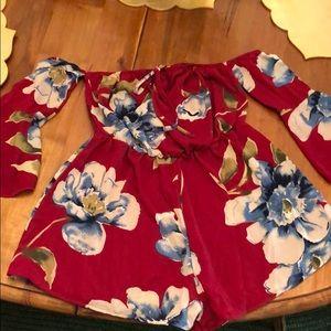 Red floral romper w long sleeves